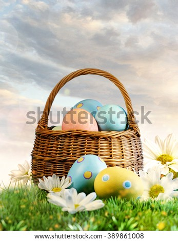 Colorful Easter eggs in basket  with flowers in the grass