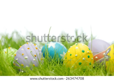 Colorful easter eggs in fresh spring green grass