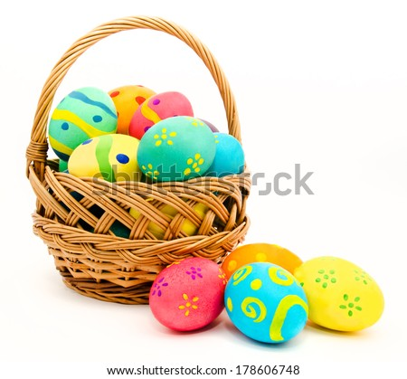 Colorful easter eggs in the basket isolated on a white background - stock photo