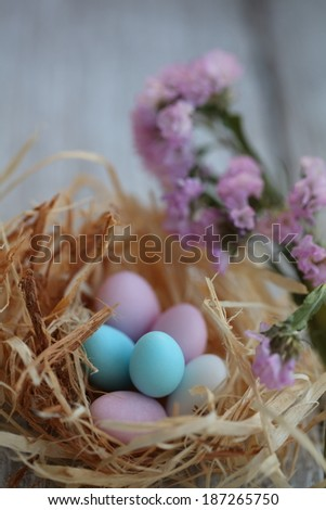 Colorful Easter eggs in the nest. Sweets in the form of eggs. - stock photo