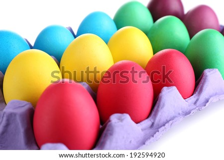Colorful Easter eggs in tray close up