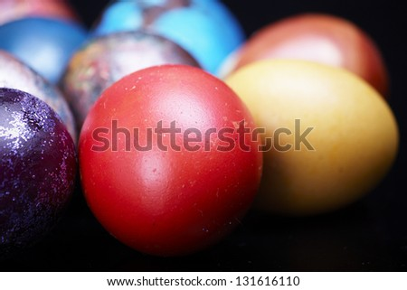Colorful Easter eggs on a dark background