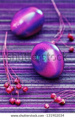 Colorful easter eggs on a purple background. - stock photo