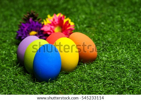 Colorful Easter eggs on grass background