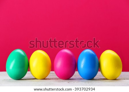 Colorful Easter eggs on pink background - stock photo