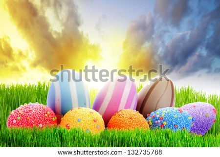 Colorful Easter eggs on the perfect meadow - stock photo