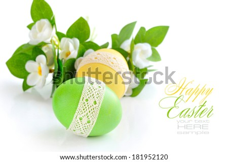 Colorful Easter Eggs on white background (with sample text) - stock photo