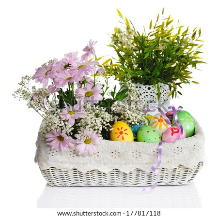 colorful easter eggs with pink flowers in basket isolated on white background - stock photo