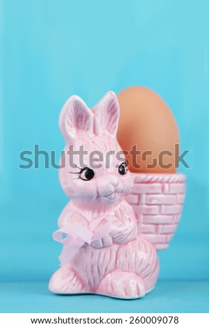 colorful egg cups with easter bunny