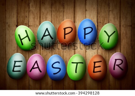 Colorful egg with happy easter typing. Happy easter concept - stock photo