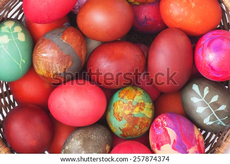 Colorful  Eggs in a Basket. Top View. Easter Background.  - stock photo