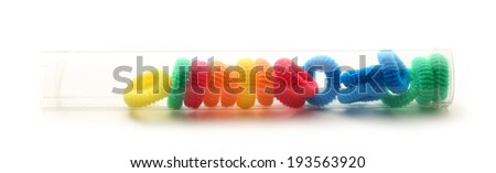 Colorful elastic hair bands in a tube - stock photo
