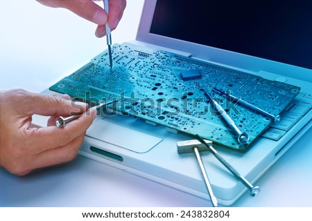 colorful electronic board and tools repairs, vibrant concept  - stock photo