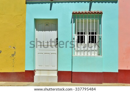Colorful elements of traditional houses in the colonial town of Trinidad in Cuba. Windows, doors - stock photo