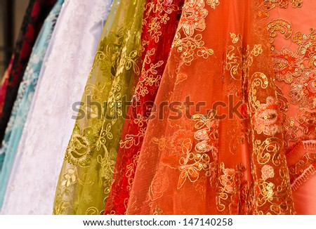 colorful embroidered spangles and bead fabric - stock photo