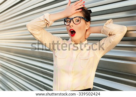 Colorful emotional summer outdoor funny beautiful pretty teacher like girl in fun sunglasses with red lips and comic stress excited surprised scream smile show headache feel - stock photo