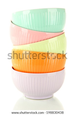 Colorful empty bowls isolated on white - stock photo