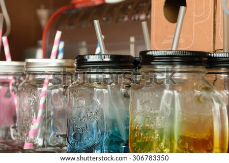 Colorful empty jar with straw vintage style - stock photo