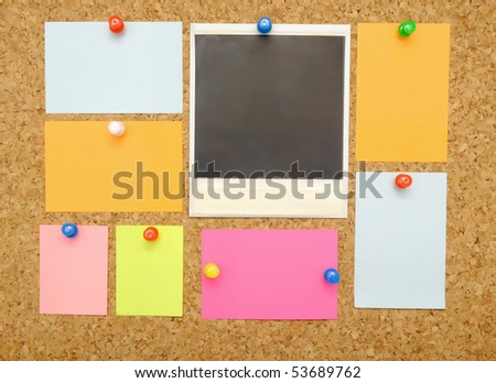 colorful empty notes over brown cork background