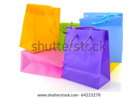 Colorful empty shopping bags isolated over white