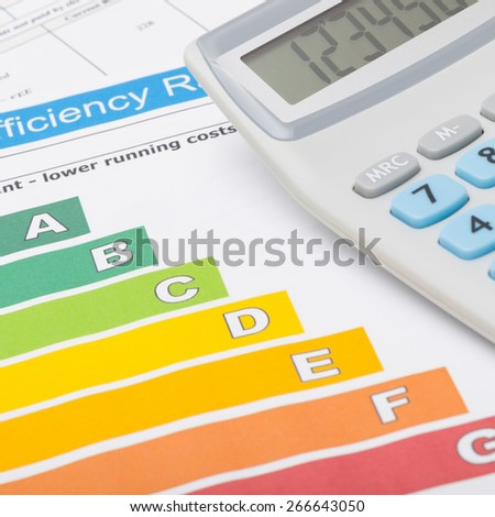 Colorful energy efficiency chart and calculator - close up shot - stock photo