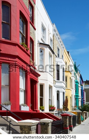 Colorful english houses facades in London near Portobello road - stock photo