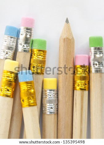 colorful erasers on pencils write - stock photo