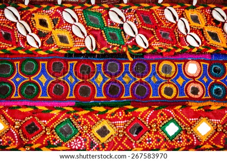 Colorful ethnic belts with mirrors and shells at market in Rajasthan, India - stock photo