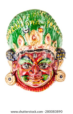 colorful ethnic nepalese mask isolated over a white background - stock photo