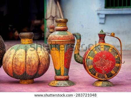 Colorful ethnic Rajasthan pots on market in Jodhpur, Rajasthan, India - stock photo