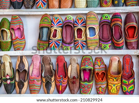 Colorful ethnic shoes at Anjuna flea market in Goa, India - stock photo