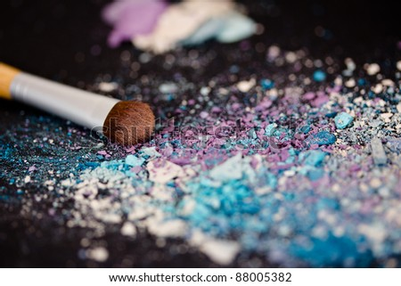 colorful eyeshadow powder and make-up brush - stock photo