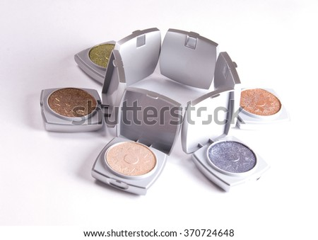 Colorful eyeshadow. Professional makeup. Cosmetics and fashion background.