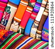 Colorful Fabric at Pisac market in Peru - stock photo