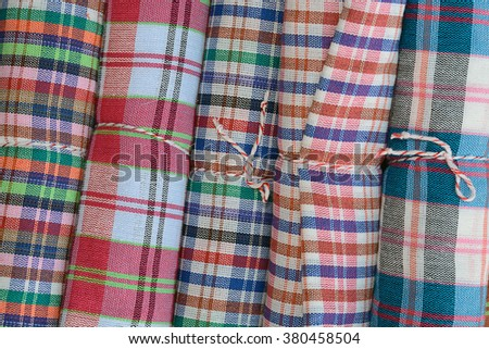 Colorful fabric rolls, traditional culture of Thailand - stock photo