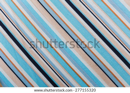 Colorful fabric texture of umbrella for background. Color pattern of an umbrella.  - stock photo