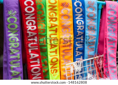 Colorful fabric with graduation text ribbon sash