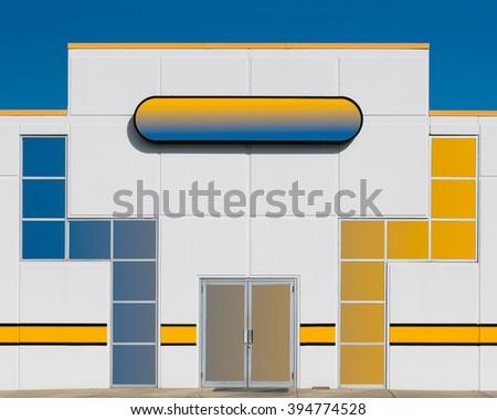 Colorful facade of suburban storefront - stock photo