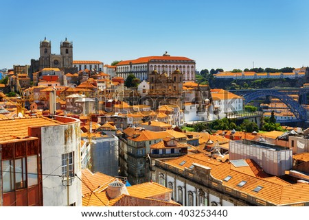 Colorful facades and roofs of houses, view of the historic centre of Porto, Portugal. It was declared a World Heritage Site by UNESCO, and it is one of the most popular tourist destinations in Europe. - stock photo