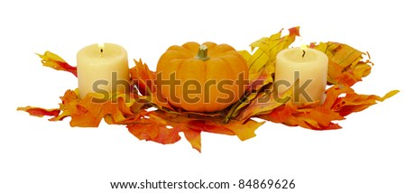 Colorful fall centerpiece with fall leaves small pumpkins and lighted candles isolated on white - stock photo