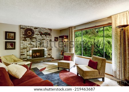Colorful family interior with brick fireplace