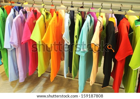 colorful  fashion clothing on hangers at the show