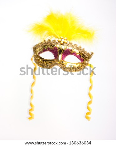 Colorful feathered Mardi Gras masquerade mask isolated on white background