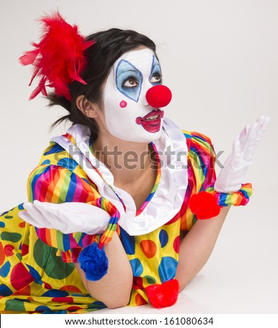 Colorful female clown actress speaking out having fun circus entertainer - stock photo