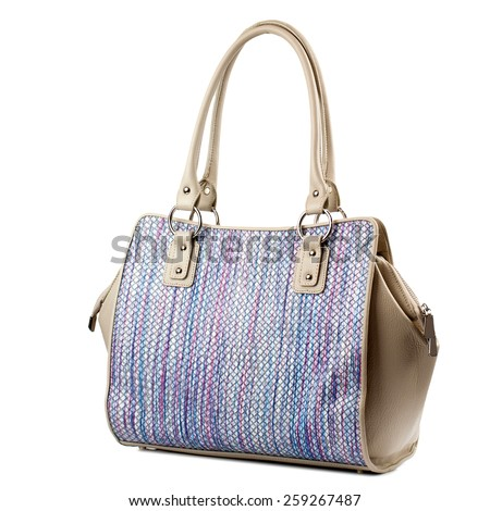 Colorful female handbag isolated on white background.
