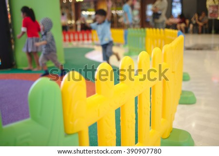 colorful fence a playground in department store. shot of indoor and selective focusing.