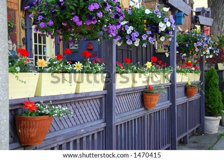 Colorful Fence Of A Restaurant Patio With Flowers