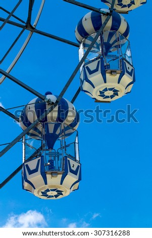colorful  ferris wheel  on bright blue sky