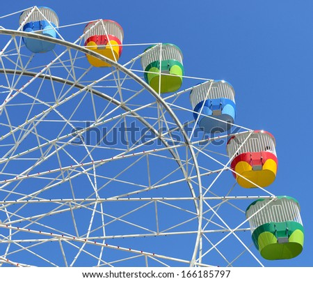 Colorful Ferris Wheel with Blue Sky at a Fair