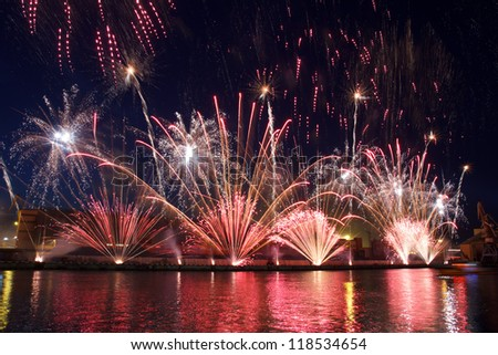 Colorful festival fireworks at the river - stock photo